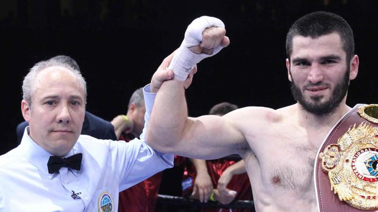 Artur Beterbiev and referee Mark Nelson