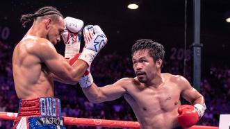 Pacquiao Decisions Thurman in a Thriller