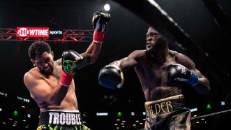 Wilder Flattens Breazeale in One, Retains World Title