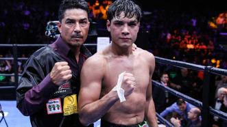 Omar Figueroa Jr. with his father