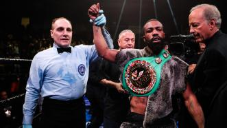 Russell Defeats a Game Nyambayar, Retains World Title